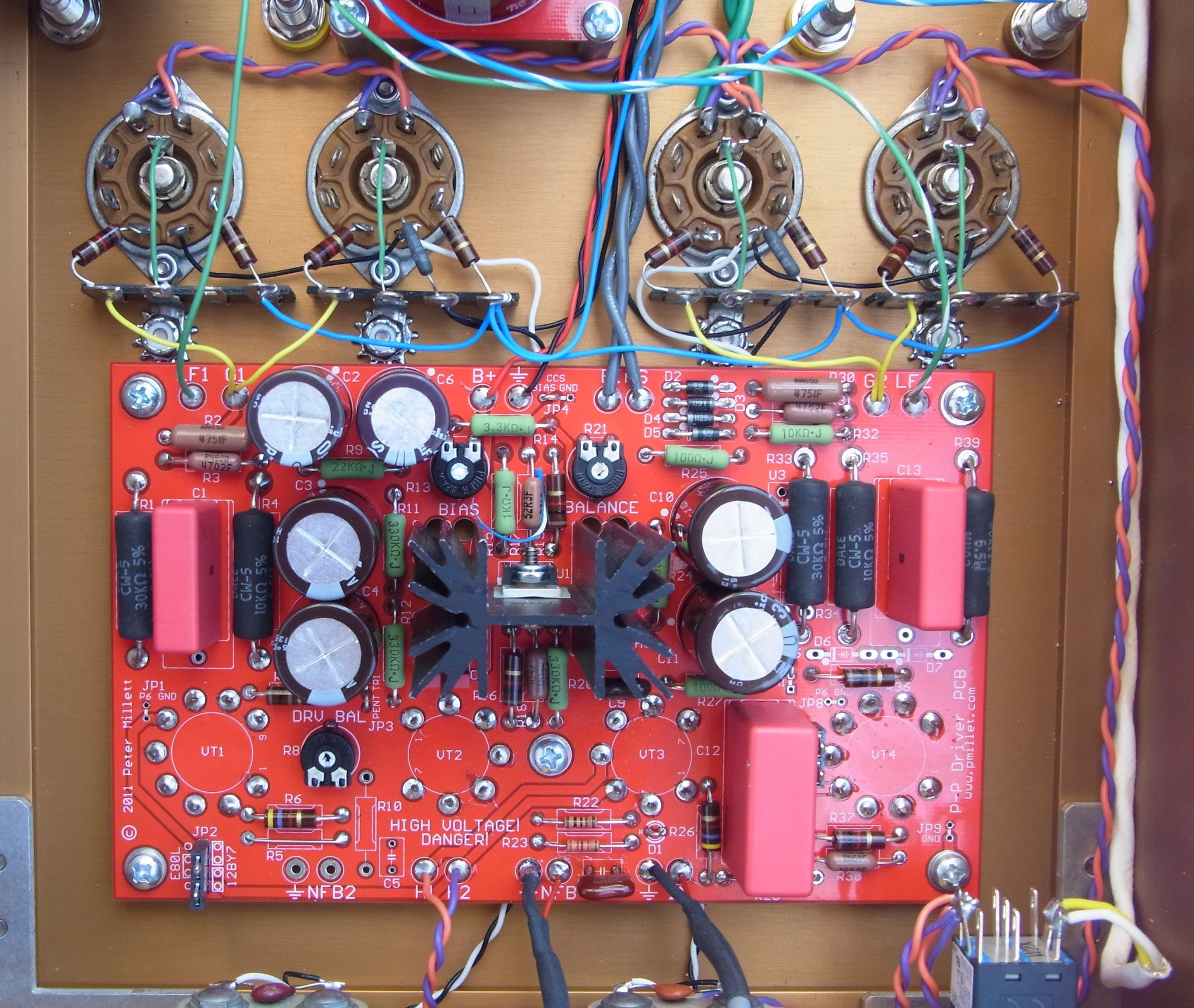 807 push pull amp 1k carbon comps mounted between the tube sockets and terminal strips which are then connected to the driver board wires as shown below